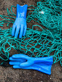 Gloves and netting Royalty Free Stock Images