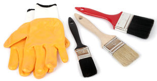 Gloves and paint brushes Royalty Free Stock Photo
