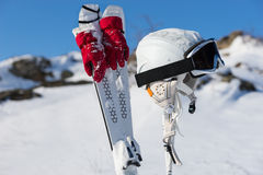 Gloves, poles and headgear for skiing theme Royalty Free Stock Photos