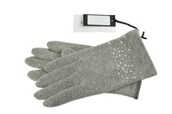Gloves with a price tag. Pair of grey woolen gloves with a blank price tag bee it, on white background Stock Images