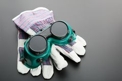 Gloves and protective glasses Royalty Free Stock Photos