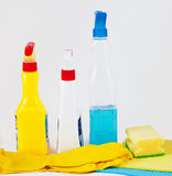 Gloves, rag, sponge and cleaning sprayers. On light bakcground stock image