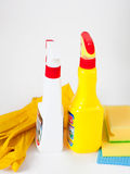 Gloves, rag, sponge and cleaning sprayers. On light bakcground royalty free stock photos