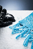 Gloves and a scarf over the snow Stock Photography