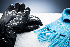 Gloves and a scarf over the snow Royalty Free Stock Photos