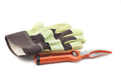 Gloves and scissors Stock Photos