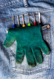 Gloves and a screwdriver in pocket. Royalty Free Stock Photos