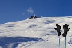 Gloves on ski poles at ski resort Royalty Free Stock Image