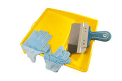 Gloves and a spatula in the pan Royalty Free Stock Photography