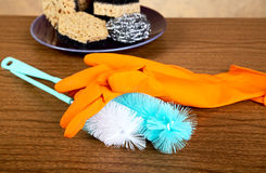 Gloves ,sponge, brush for ware washing Royalty Free Stock Photos