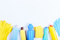 Gloves, sponges, bottles of cleaning fluids on a white table, sp Stock Image