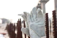 gloves and steel bars on concrete background. stock images