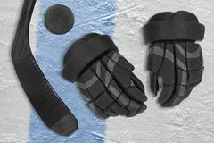 Set on ice hockey accessories. Gloves, stick and puck on the ice hockey rink. Concept, hockey Stock Images