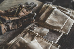 Gloves and tool belt Stock Image