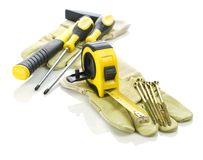 Gloves with tools for building Royalty Free Stock Image