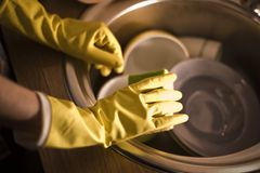 Gloves for washing dishes. On a wooden background Royalty Free Stock Images