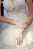 Gloves and wedding dress Royalty Free Stock Photos