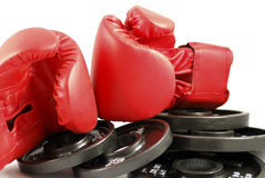 Gloves and weights Royalty Free Stock Photos