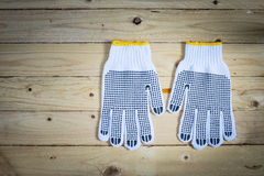 Gloves on wooden background Stock Photo