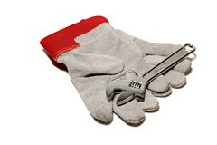 Gloves and wrench Royalty Free Stock Photos