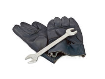 Gloves and wrench Stock Images