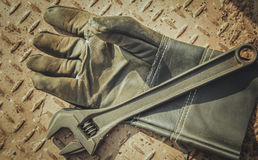 Gloves and  wrench Stock Photo