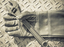 Gloves and  wrench Royalty Free Stock Photography