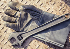 Gloves and  wrench Royalty Free Stock Image