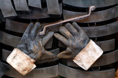 Gloves and wrenches. Put on the train brake pads Stock Photo