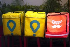 Glovo and Rappi boxes, food delivery service stock images