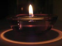Glow. Tealight candle Stock Photos