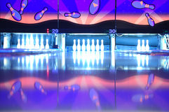 Glow bowling. A full rack pins set up and ready for glow bowling Stock Photos