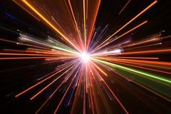 Glow color light particles explosion Stock Photos