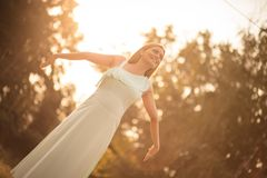 Glow comes from within. Happy pregnant woman in nature. Copy space stock photo