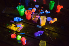 Glow in the dark paint tools. On a table Stock Image