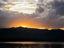 THE GLOW OF DAWN OVER LAKE KIVU. Image of the golden glow of the rising sun over Lake Kivu in the Democratic Republic of Congo Stock Photography