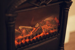 Glow from an electric fireplace. Stock Photos