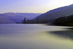 Glow of evening light over Talybont Reservoir Royalty Free Stock Photo