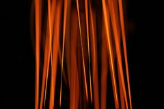 Glow with an incandescent lamp. Glow of an incandescent lamp on a dark background Stock Images