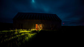 Glow of light from a barn. The glow of light from a barn in Prince Edward Island Royalty Free Stock Image