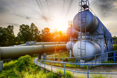 Glow light of petrochemical industry on sunset. Royalty Free Stock Photos