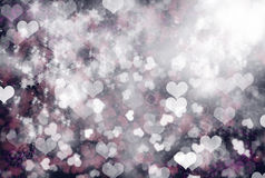 Glow of Love - sparkle hearts background. Glowing Hearts on dark background with shiny and glowing stars, sparkling love on valentine's day Stock Photography