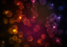 Glow multicolor hexagons on dark background Stock Photography