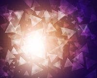 Glow multicolor triangles on dark background Stock Photos