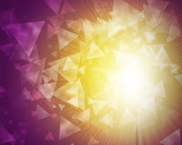 Glow multicolor triangles on dark background Stock Photography