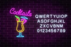 Glow neon sign of cocktails bar with alphabet. Glowing gas advertising with pina colada alcohol shake. Glow neon sign of cocktails bar with alphabet on dark Royalty Free Stock Photo