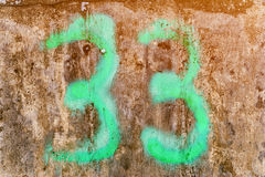 Glow 33. Number 33 on concrete background Stock Photos