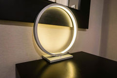 Glow round modern and luxury lamp in hotel bedroom Stock Photo