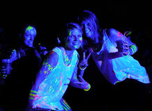 Glow Run Port Elizabeth 2014 South Africa. Splattered with colourful fluorescent paint these revelers got festive at the 2014 Glow Run Port Elizabeth in South Stock Photography