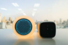 Glow speaker in orange color and modern wireless speaker for listening to music Stock Images